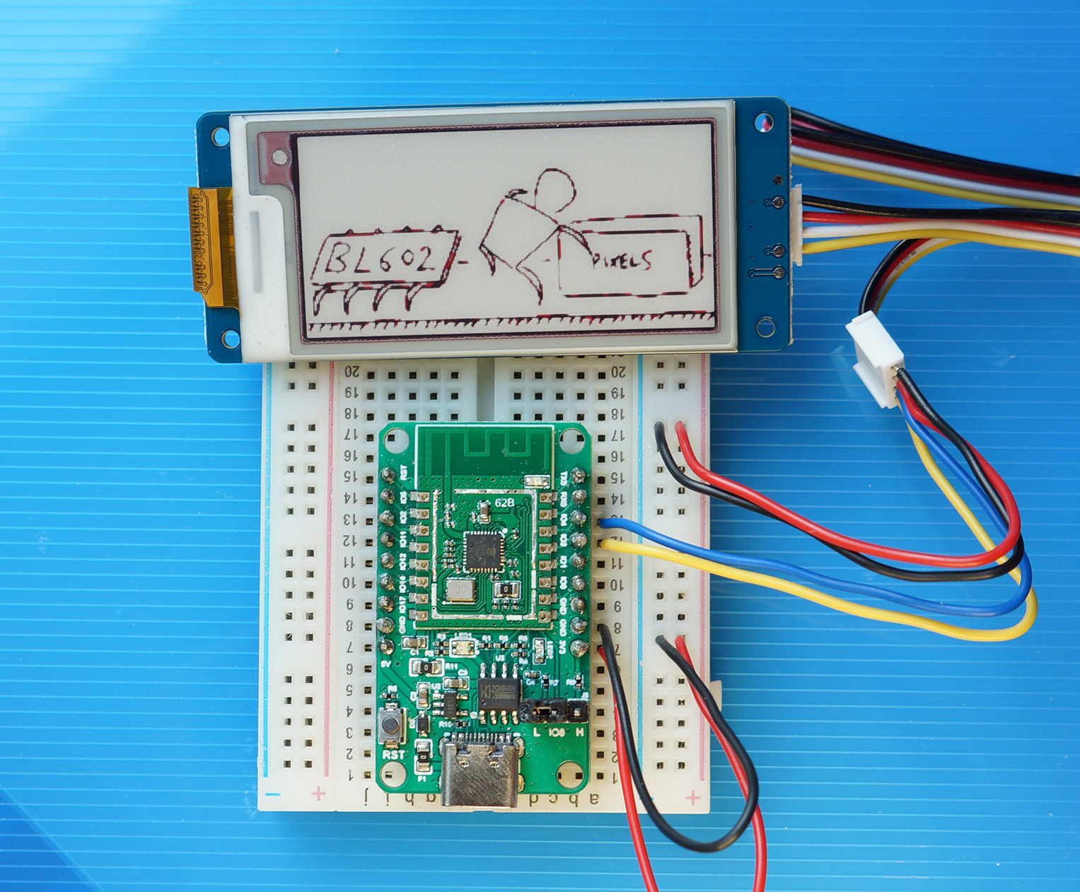 PineCone BL602 RISC-V Board rendering an image on Grove Triple Colour E-Ink Display with UART Interface